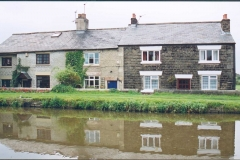 Three cottages on the canal bank